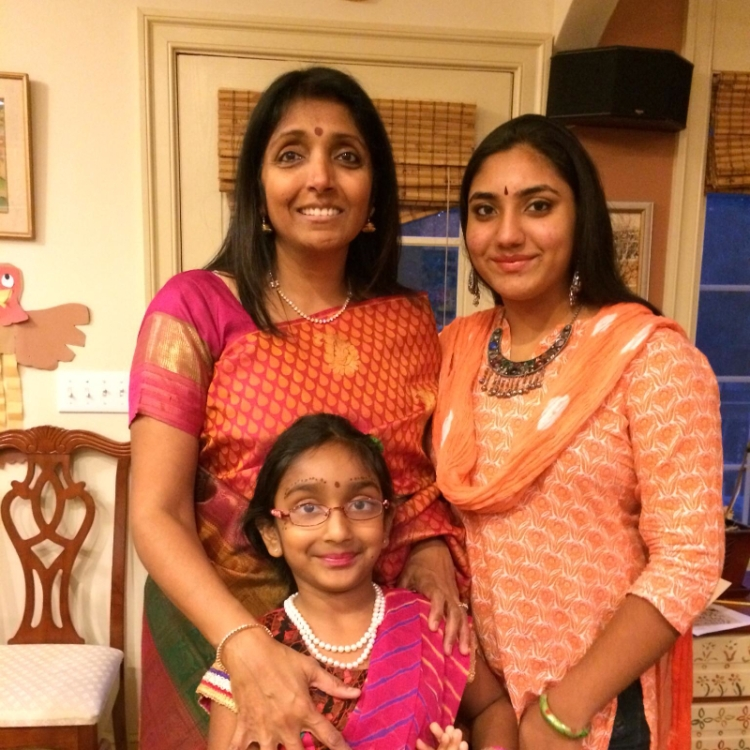 Priya with her beautiful family. Shreya, inspiration for the character Fey Fey, is in the front.